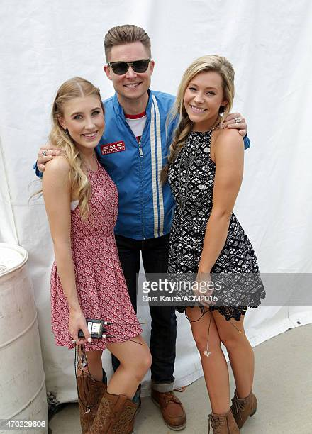 Singer/songwriter Frankie Ballard poses with Madison Marlow and Taylor Dye of Maddie Tae backstage during the ACM Party For A Cause Festival at Globe...