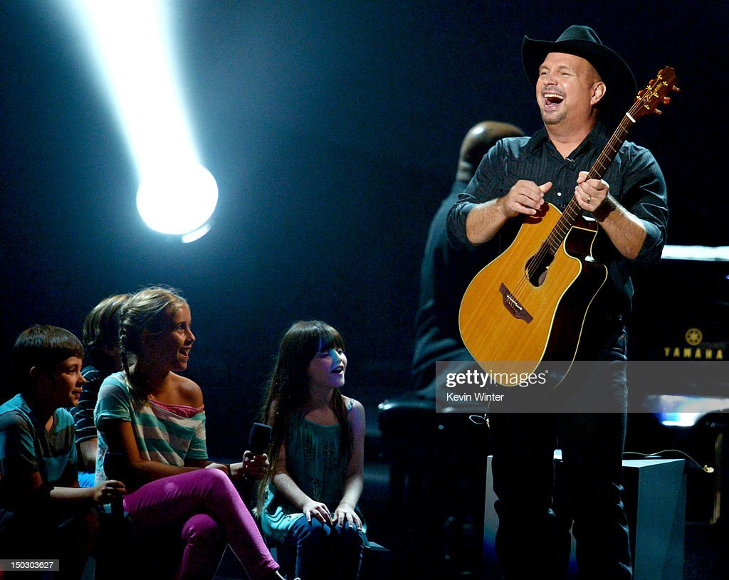 Singer/songwriter <a gi-track='captionPersonalityLinkClicked' href=/galleries/search?phrase=Garth+Brooks&family=editorial&specificpeople=206288 ng-click='$event.stopPropagation()'>Garth Brooks</a> performs at CBS' Teachers Rock Special live concert at the Nokia Theatre L.A. Live on August 14, 2012 in Los Angeles, California.