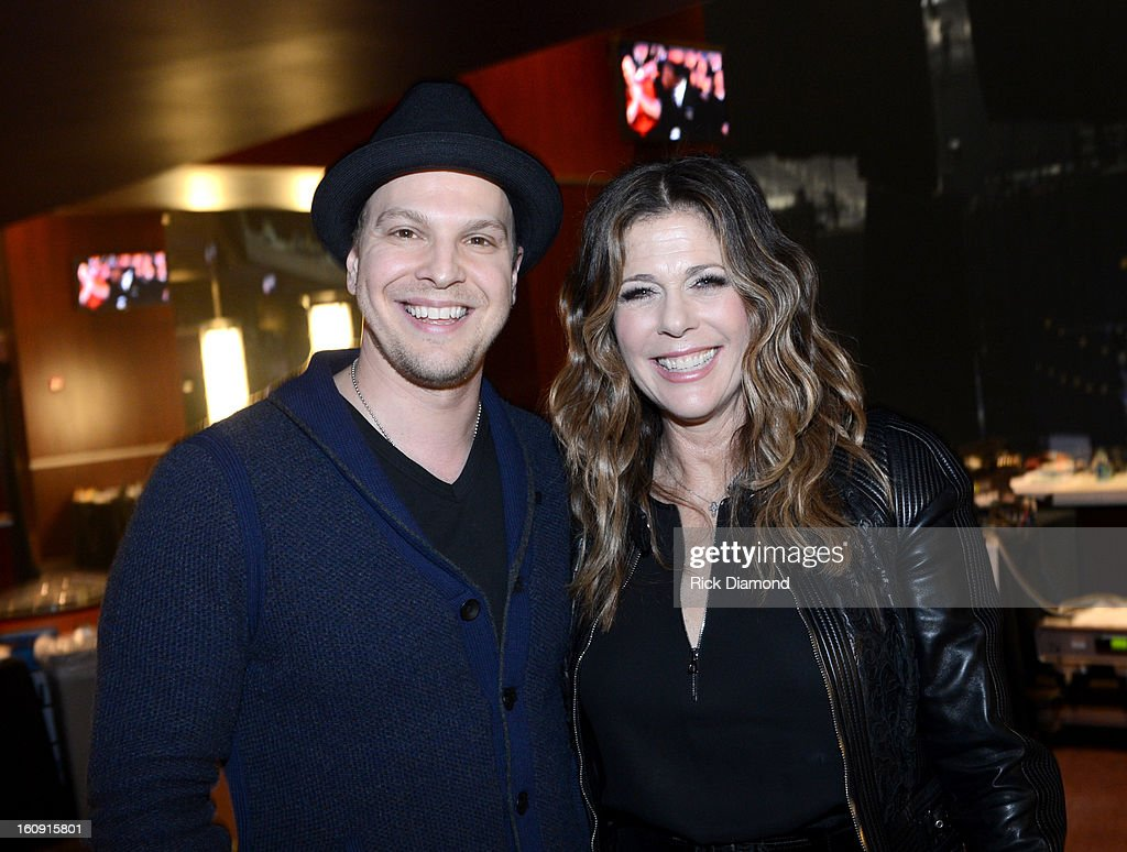Singer/songwriter Gavin DeGraw (L) and actress Rita Wilson pose backstage at the GRAMMYs Dial Global Radio Remotes during The 55th Annual GRAMMY Awards at the STAPLES Center on February 7, 2013 in Los Angeles, California.