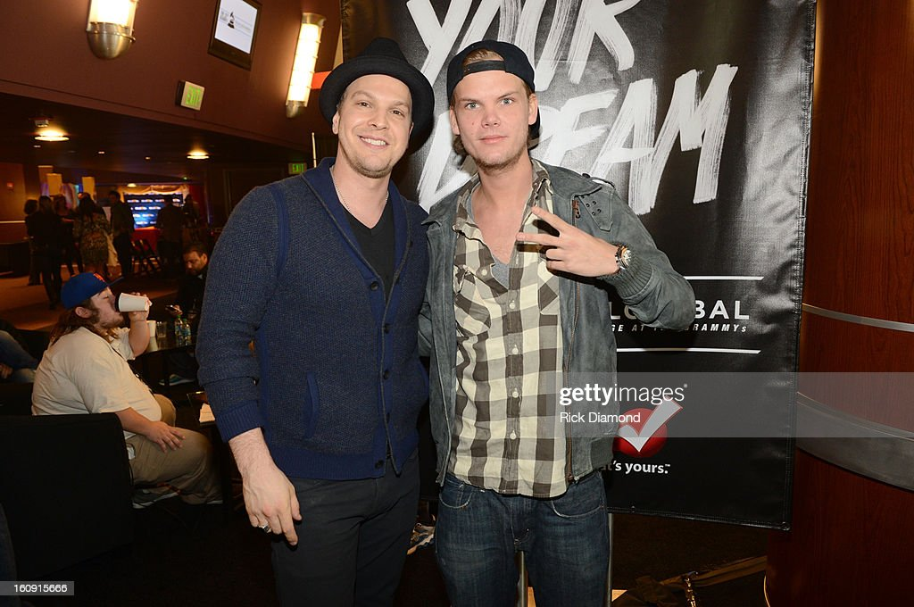 Singer/songwriter Gavin DeGraw (L) and DJ Avicii pose backstage at the GRAMMYs Dial Global Radio Remotes during The 55th Annual GRAMMY Awards at the STAPLES Center on February 7, 2013 in Los Angeles, California.