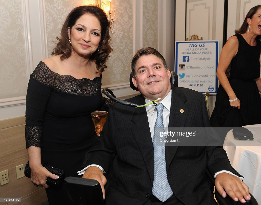 Singer-songwriter Gloria Estefan (L) and President of The Buoniconti Fund, Marc Buoniconti attend the 30th Annual Great Sports Legends Dinner to benefit The Buoniconti Fund to Cure Paralysis at The Waldorf Astoria on October 6, 2015 in New York City.