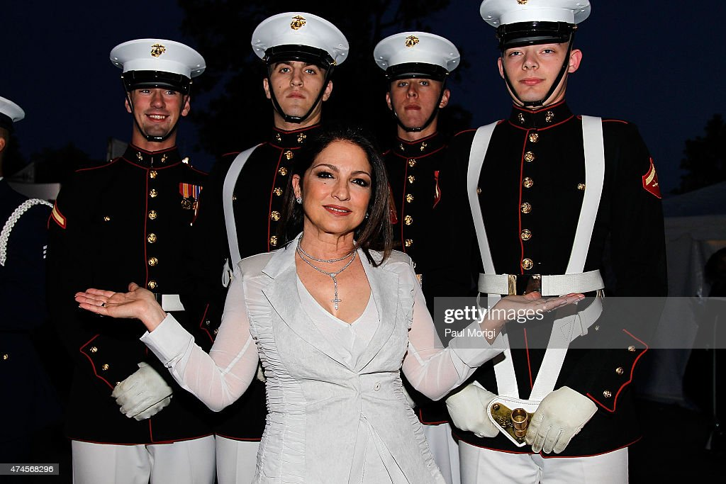 Singer-songwriter Gloria Estefan poses for a photo with Marines at the 26th National Memorial Day Concert Rehearsals on May 23, 2015 in Washington, DC.
