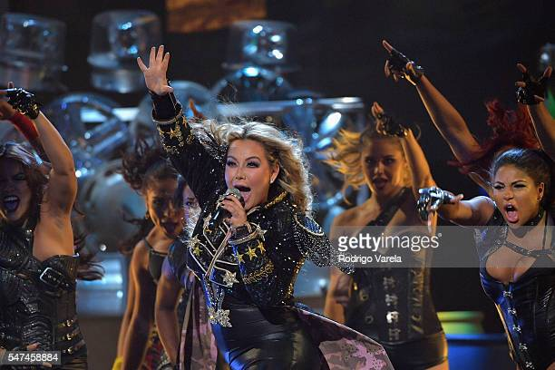 Singersongwriter Gloria Trevi performs onstage at the Univision's 13th Edition Of Premios Juventud Youth Awards at Bank United Center on July 14 2016...