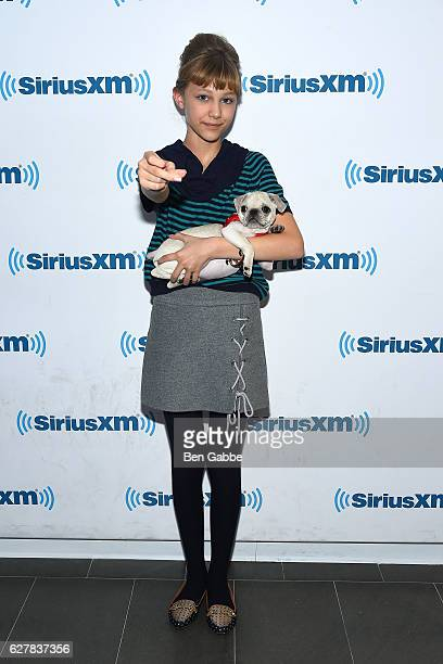 Singersongwriter Grace VanderWaal with her dog Frankie at SiriusXM Studio on December 5 2016 in New York City