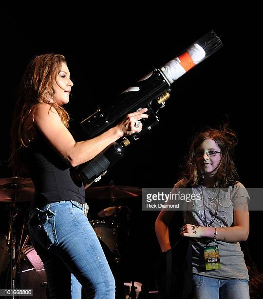 COVERAGE*** Singer/Songwriter Gretchen Wilson and Her Daughter Grace Wilson helps Mom during the 2010 BamaJam Music Arts Festival at the corner of...