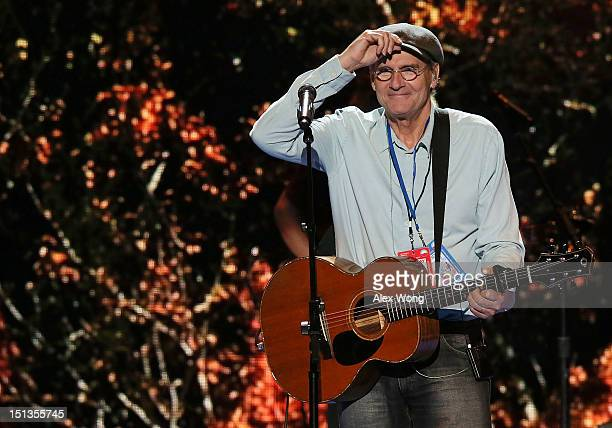 Singersongwriter James Taylor acknowledges the crowd as he rehearses for his performance on the last day of the Democratic National Convention at...