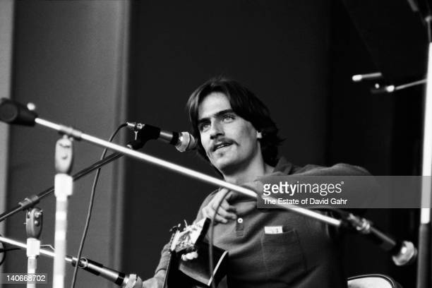 Singersongwriter James Taylor performs at the Newport Folk Festival in July 1969 in Newport Rhode Island