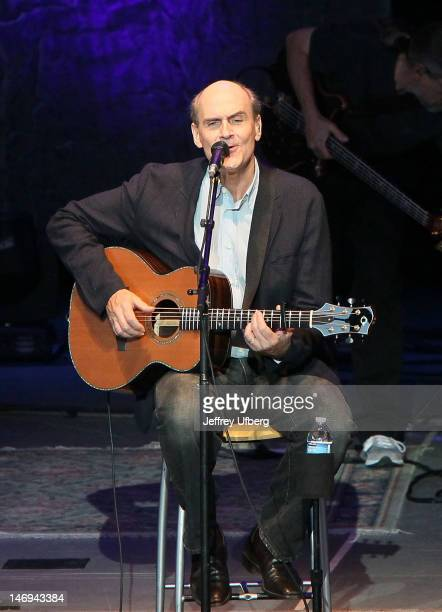 Singer/songwriter James Taylor performs at the PNC Bank Arts Center on June 23 2012 in Holmdel New Jersey