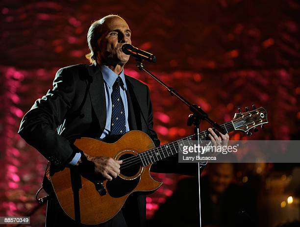 Singer/songwriter James Taylor performs on stage during the 40th Annual Songwriters Hall of Fame Ceremony at The New York Marriott Marquis on June 18...