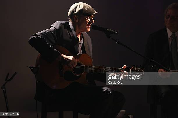 Singersongwriter James Taylor performs onstage alongside radio DJ Jim Kerr during iHeartRadio ICONS with James Taylor presented by PC Richard Son at...