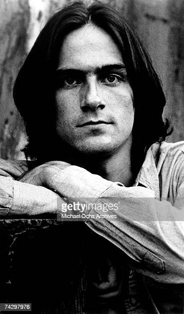 Singer/songwriter James Taylor poses for a portrait in circa 1974