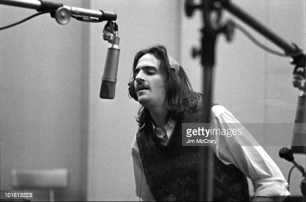 Singersongwriter James Taylor provides backing vocals during the recording of Carole King's album 'Tapestry' at AM Records Recording Studio in...
