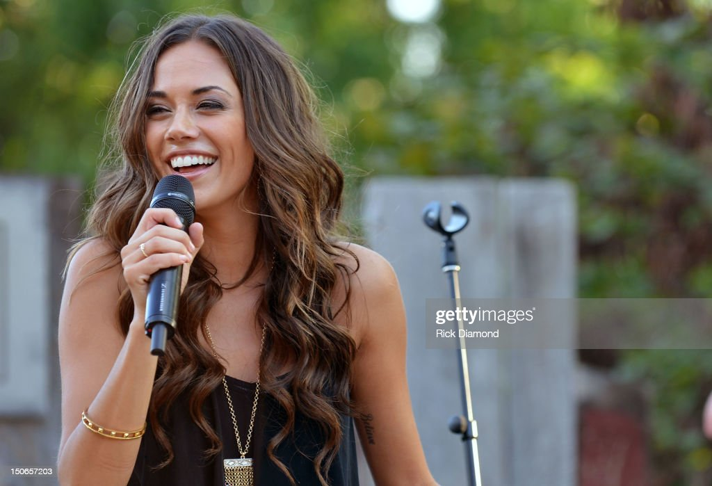 Singer/Songwriter Jana Kramer performs during Warner Music Nashville's Pickin' on the Patio, on the patio at the Warner Brothers offices on August 23, 2012 in Nashville, Tennessee.