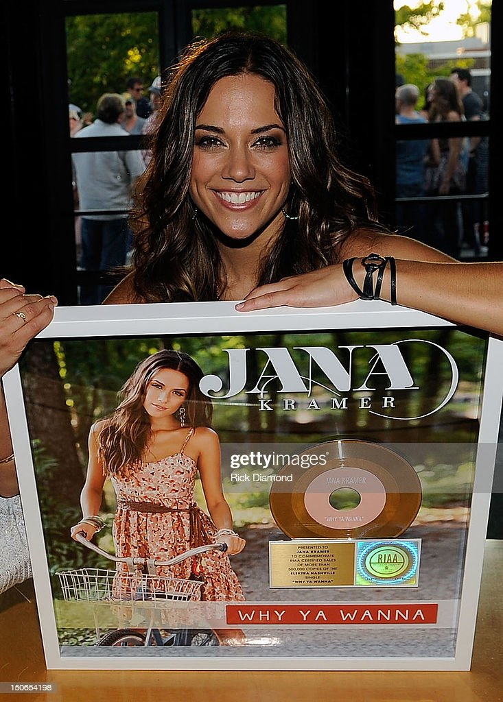 Singer/Songwriter Jana Kramer poses with her GOLD record for the hit single 'Why Ya Wanna' performed by Janna Kramer during Warner Music Nashville's Pickin' on the Patio on the patio at the Warner Brothers offices on August 23, 2012 in Nashville, Tennessee.