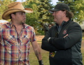 Singer/Songwriter Jason Aldean chats with Country Thunder Promoter/CEO /President Premier Global Productions Troy Vollhoffer backstage at Country...