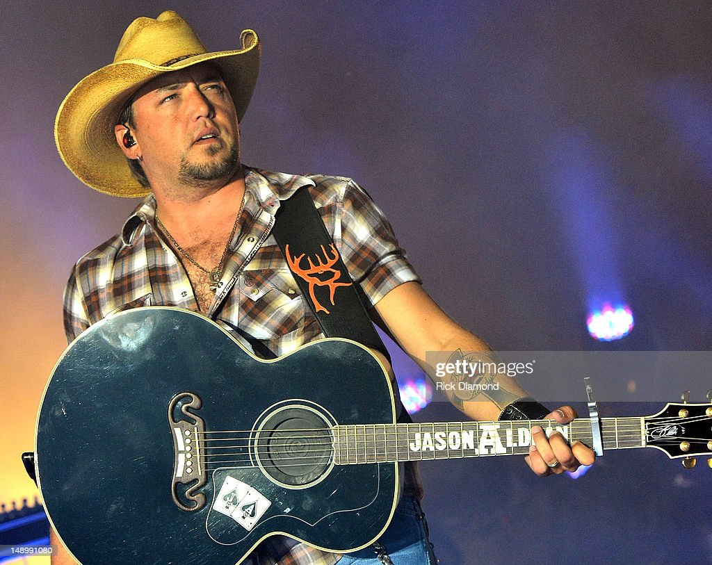 Singer/Songwriter <a gi-track='captionPersonalityLinkClicked' href=/galleries/search?phrase=Jason+Aldean&family=editorial&specificpeople=619221 ng-click='$event.stopPropagation()'>Jason Aldean</a> performs at Country Thunder - Day 2 on July 20, 2012 in Twin Lakes, Wisconsin.