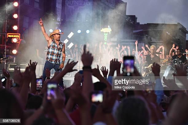 Singersongwriter Jason Aldean performs on stage during rehearsals at Bridgestone Arena on June 7 2016 in Nashville Tennessee
