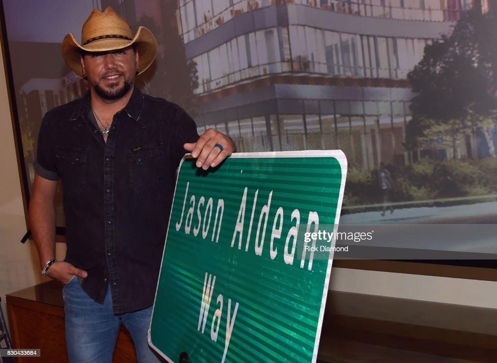 Singer/Songwriter Jason Aldean with signage for 'Jason Aldean Way' at The Medical Center, Navicent Health's Eversole Auditorium on August 11, 2017 in Macon, Georgia.