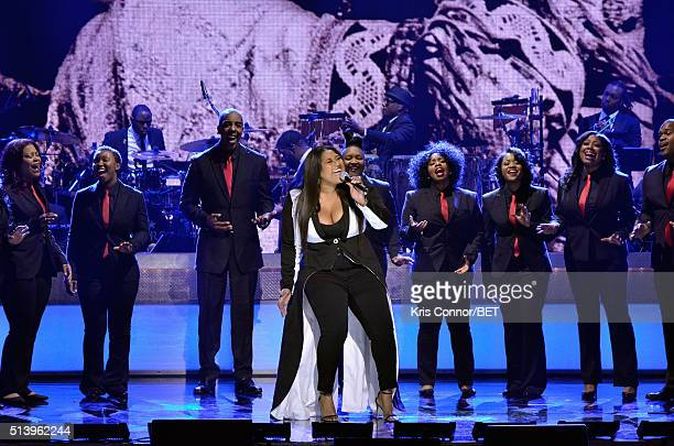 Singersongwriter Jazmine Sullivan performs on stage with the Destiny Rode Choir at the BET Honors 2016 Show at Warner Theatre on March 5 2016 in...
