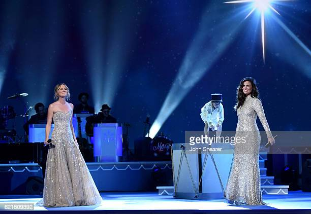 Singersongwriter Jennifer Nettles and Actress Idina Menzel perform on stage during the CMA 2016 Country Christmas on November 8 2016 in Nashville...