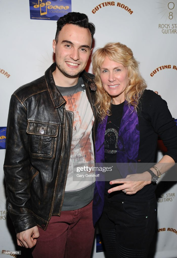 Singer-songwriter Jesse Clegg (L) and author and photographer Lisa Johnson attend the book launch and performance for '108 Rock Star Guitars' benefitting The Les Paul Foundation at The Cutting Room on October 8, 2013 in New York City.