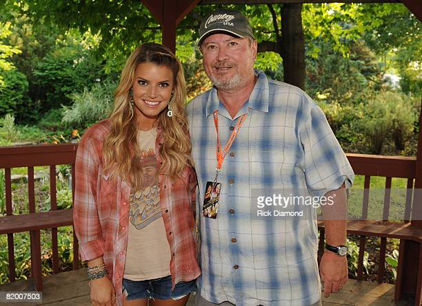 TWIN LAKES WI JULY 18 Singer/Songwriter Jessica Simpson and Booking Agent NEM Entertainment Gil Cunningham backstage during the 16th annual Country...