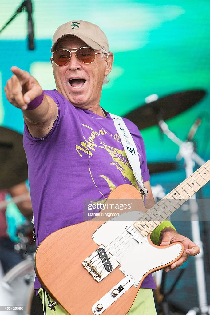 Singer/songwriter <a gi-track='captionPersonalityLinkClicked' href=/galleries/search?phrase=Jimmy+Buffett&family=editorial&specificpeople=216341 ng-click='$event.stopPropagation()'>Jimmy Buffett</a> performs on stage at FinFest on August 9, 2014 in Hermosa Beach, California.