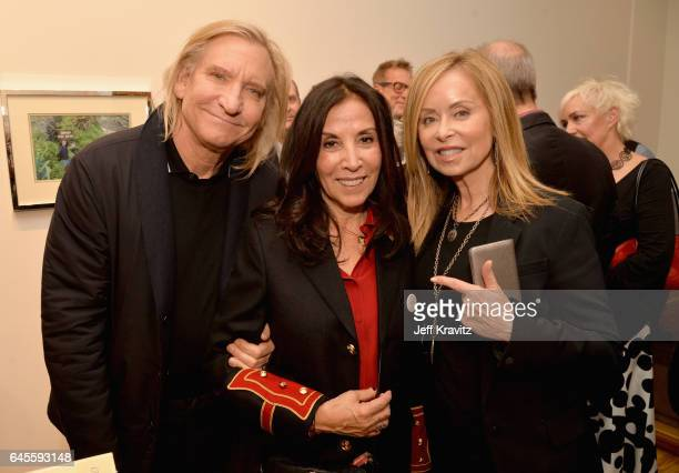 Singersongwriter Joe Walsh of The Eagles author Olivia Harrison and Marjorie Bach attend the 'I ME MINE' George Harrison book launch at Subliminal...