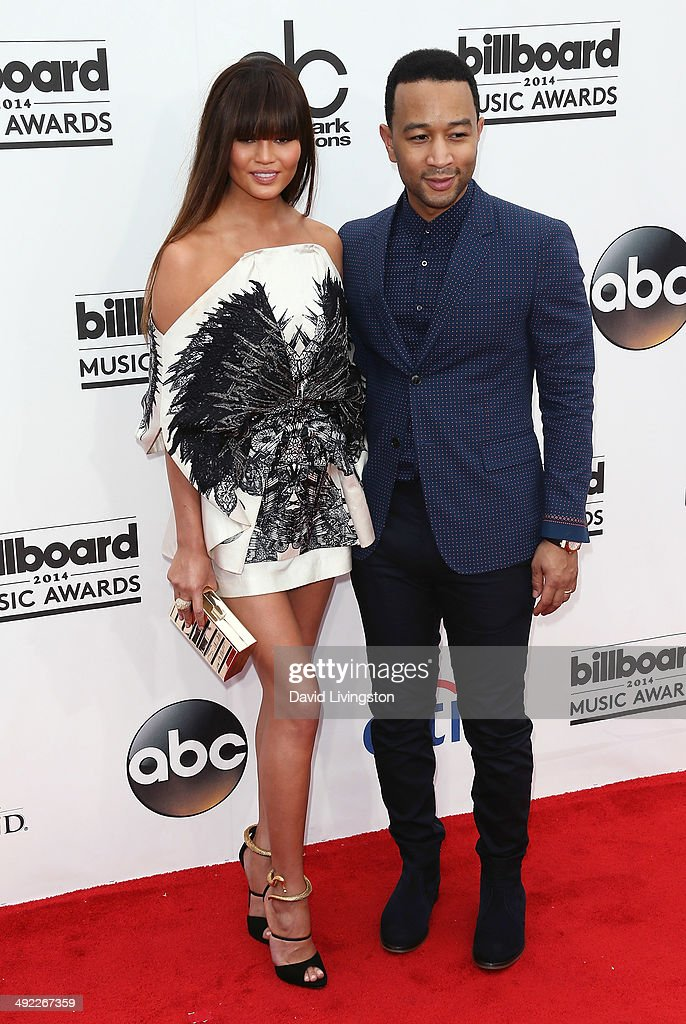 Singer/songwriter <a gi-track='captionPersonalityLinkClicked' href=/galleries/search?phrase=John+Legend&family=editorial&specificpeople=201468 ng-click='$event.stopPropagation()'>John Legend</a> (R) and wife model <a gi-track='captionPersonalityLinkClicked' href=/galleries/search?phrase=Christine+Teigen&family=editorial&specificpeople=4583768 ng-click='$event.stopPropagation()'>Christine Teigen</a> attend the 2014 Billboard Music Awards at the MGM Grand Garden Arena on May 18, 2014 in Las Vegas, Nevada.