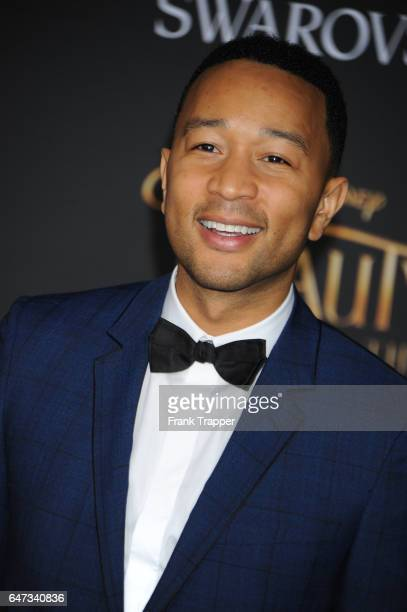 Singer/songwriter John Legend attends Disney's 'Beauty and the Beast' premiere at El Capitan Theatre on March 2 2017 in Los Angeles California