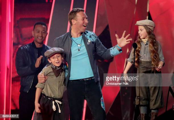 Singersongwriter John Legend reacts as singersongwriter Chris Martin of music group Coldplay and guests accept the Best Tour award onstage at the...