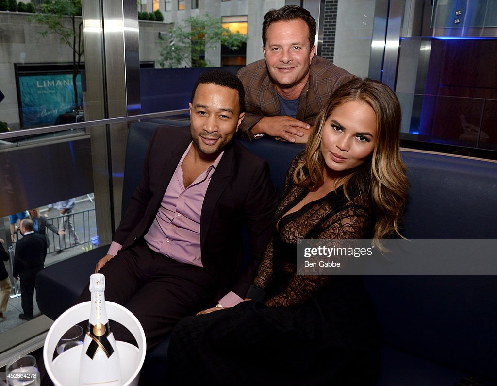 Singer-songwriter <a gi-track='captionPersonalityLinkClicked' href=/galleries/search?phrase=John+Legend&family=editorial&specificpeople=201468 ng-click='$event.stopPropagation()'>John Legend</a>, Sr VP and managing director of IMG Models Ivan Bart and model Chrissy Teigen attend DuJour Magazine and NYY Steak celebrating Chrissy Teigen with FENDI timepieces and Moet Ice on July 28, 2014 in New York City.