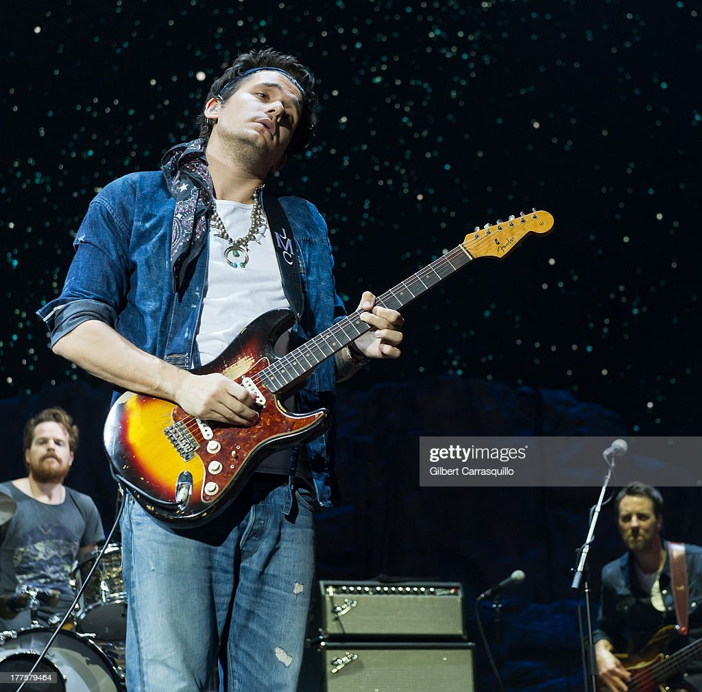 Singer-songwriter John Mayer performs during Born and Raised World Tour 2013 at Susquehanna Bank Center on August 23, 2013 in Camden, New Jersey.