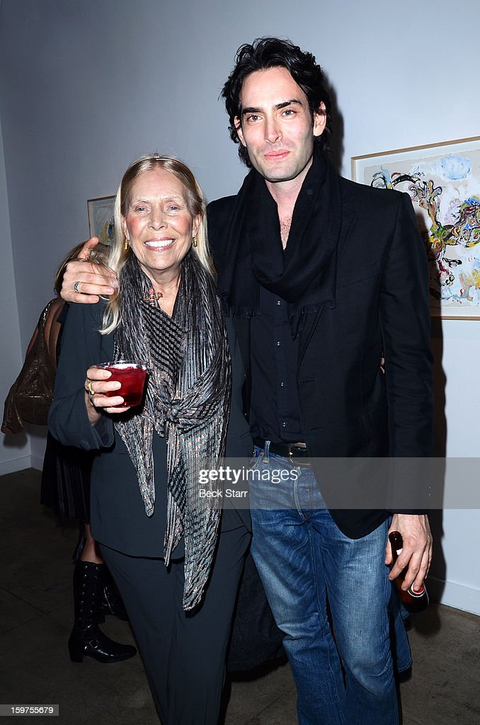 Singer/songwriter Joni MItchell and artist Alexander Yullish attend his art exhibition and opening 'Interior Stories' at Gallery Brown on January 19, 2013 in Los Angeles, California.