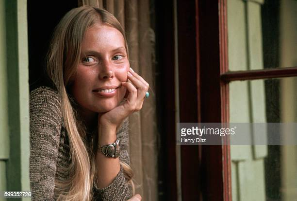 Singersongwriter Joni Mitchell looks out a window at her Laurel Canyon home Mitchell remains one of the most acclaimed songwriters and performers of...