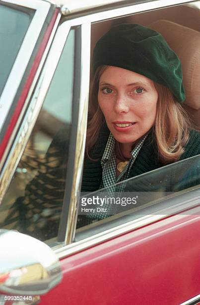 Singersongwriter Joni Mitchell rests in the drivers seat of a car Mitchell remains one of the most acclaimed songwriters and performers of rock music...
