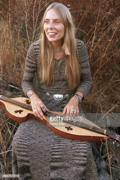 Singersongwriter Joni Mitchell sitting in a meadow with a mountain dulcimer at her Laurel Canyon home Mitchell remains one of the most acclaimed...