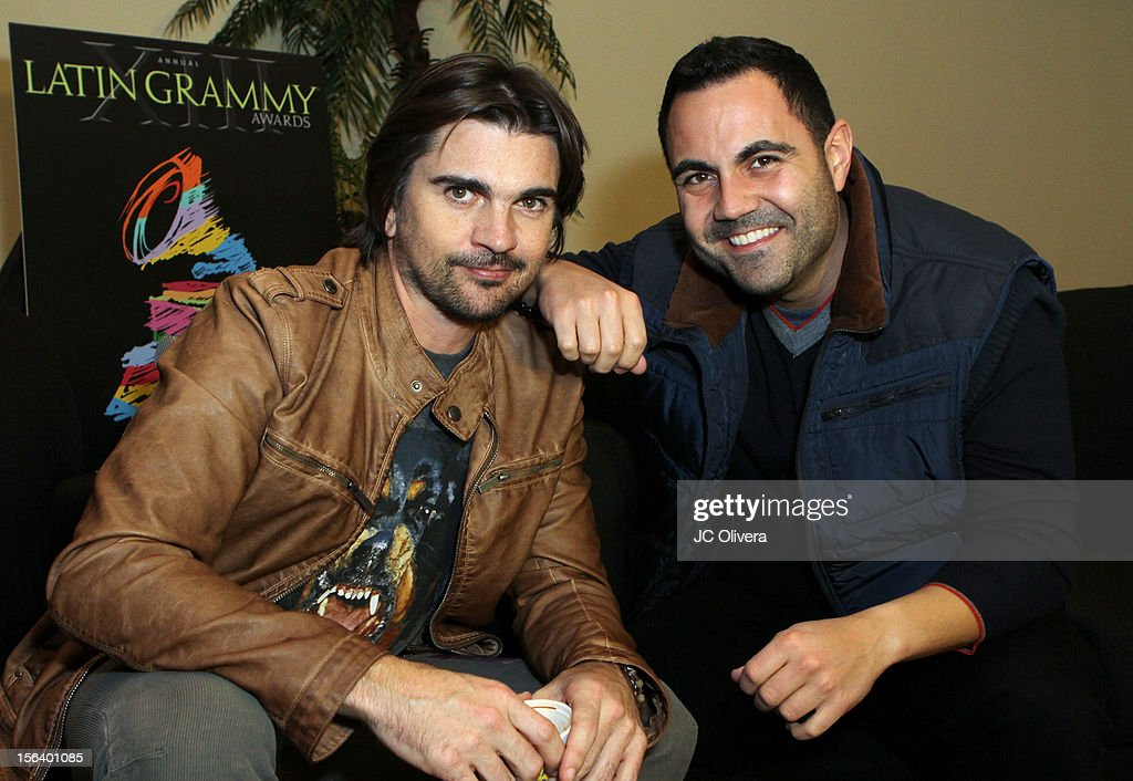 Singer/songwriter <a gi-track='captionPersonalityLinkClicked' href=/galleries/search?phrase=Juanes&family=editorial&specificpeople=202467 ng-click='$event.stopPropagation()'>Juanes</a> (L) and radio personality <a gi-track='captionPersonalityLinkClicked' href=/galleries/search?phrase=Enrique+Santos+-+Personnalit%C3%A9+de+la+t%C3%A9l%C3%A9vision&family=editorial&specificpeople=15214264 ng-click='$event.stopPropagation()'>Enrique Santos</a> attend the 13th annual Latin GRAMMY Awards Univision Radio Remotes held at the Mandalay Bay Events Center on November 14, 2012 in Las Vegas, Nevada.