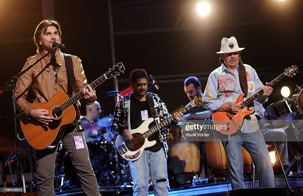 Singer/songwriter Juanes (L) and recording artist Carlos Santana (R) perform onstage during rehearsals for the 13th annual Latin GRAMMY Awards at the Mandalay Bay Events Center on November 14, 2012 in Las Vegas, Nevada.