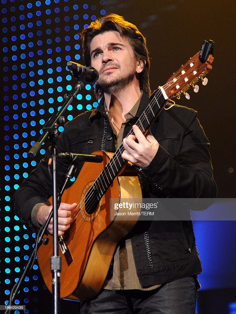 Singer/songwriter <a gi-track='captionPersonalityLinkClicked' href=/galleries/search?phrase=Juanes&family=editorial&specificpeople=202467 ng-click='$event.stopPropagation()'>Juanes</a> performs onstage during the 2012 Latin Recording Academy Person Of The Year honoring Caetano Veloso at the MGM Grand Garden Arena on November 14, 2012 in Las Vegas, Nevada.