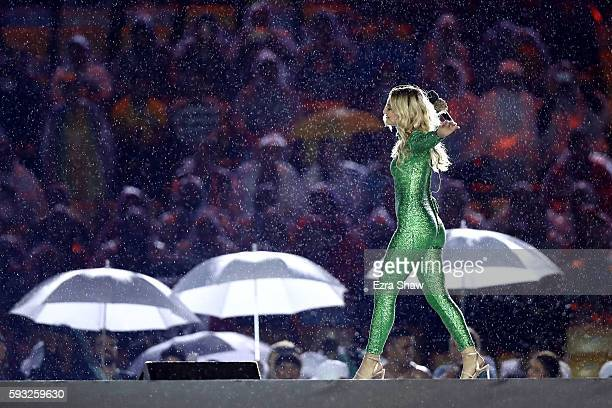 Singersongwriter Julia Michaels perform the song 'Carry Me' during the Closing Ceremony on Day 16 of the Rio 2016 Olympic Games at Maracana Stadium...