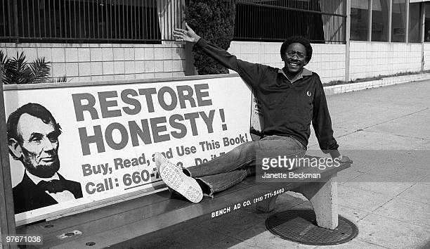 Singer/songwriter Junior Giscombe poses for a portait sitting on a bus bench with an advertisement that reads 'Restore Honesty' on Hollywood...