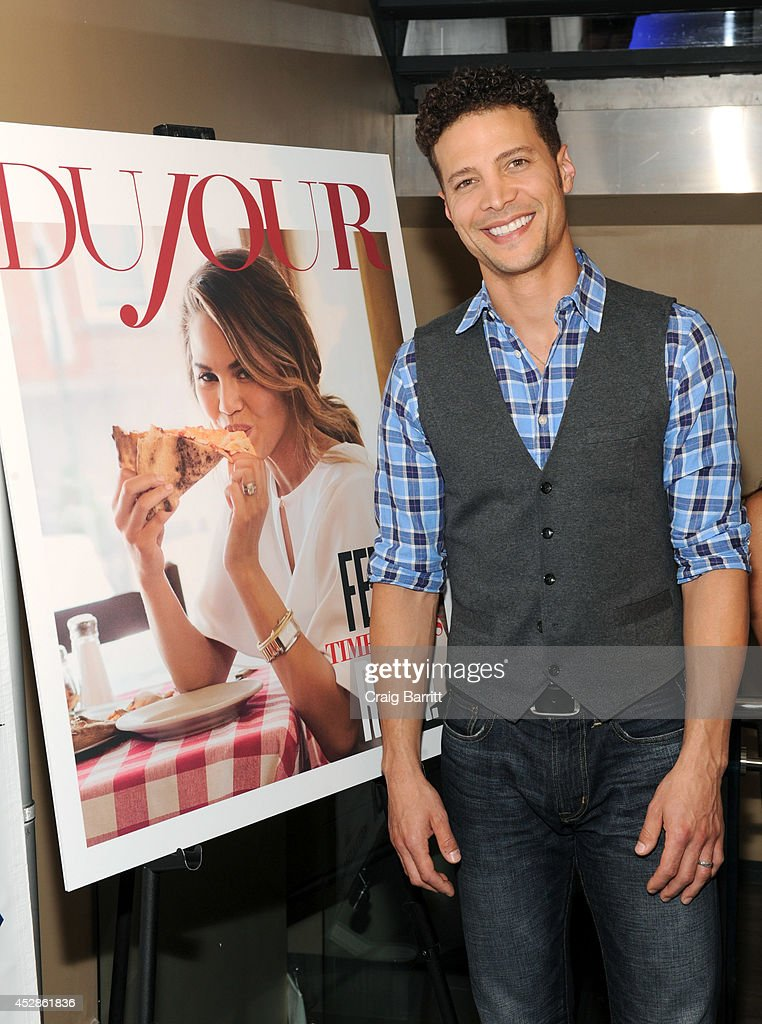 Singer-songwriter Justin Guarini attends DuJour Magazine and NYY Steak celebrating Chrissy Teigen with FENDI timepieces and Moet Ice on July 28, 2014 in New York City.