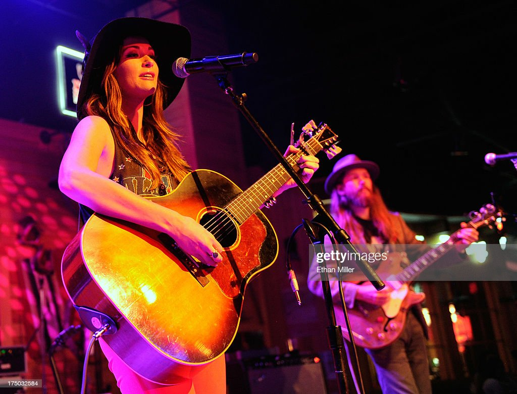 Singer/songwriter Kacey Musgraves (L) and musician Kyle Ryan perform at Gilley's Saloon, Dance Hall & Bar-B-Que at the Treasure Island Hotel & Casino as she tours in support of the album 'Same Trailer Different Park' on July 29, 2013 in Las Vegas, Nevada.