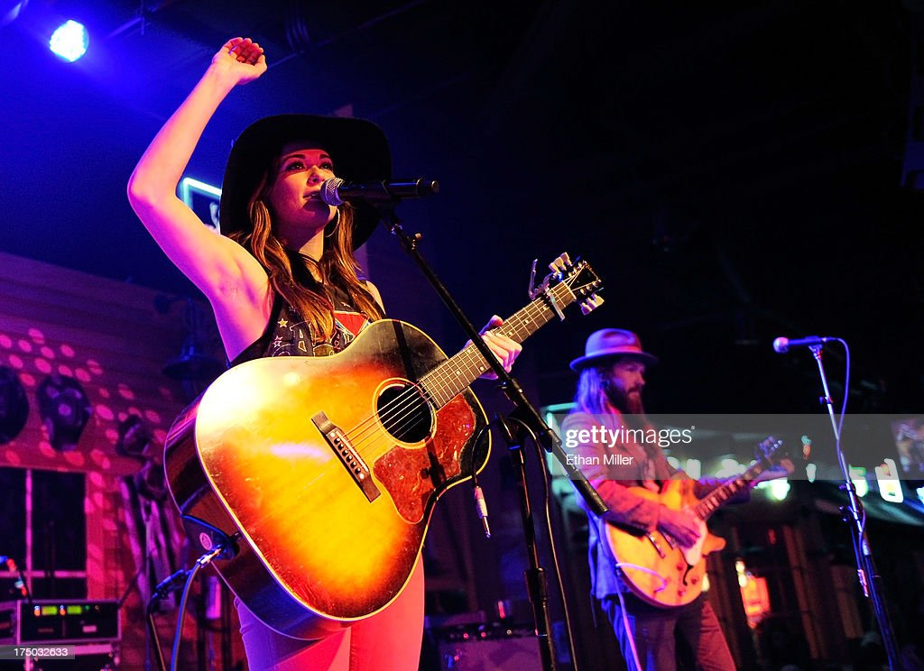 Singer/songwriter <a gi-track='captionPersonalityLinkClicked' href=/galleries/search?phrase=Kacey+Musgraves&family=editorial&specificpeople=4103138 ng-click='$event.stopPropagation()'>Kacey Musgraves</a> (L) and musician Kyle Ryan perform at Gilley's Saloon, Dance Hall & Bar-B-Que at the Treasure Island Hotel & Casino as she tours in support of the album 'Same Trailer Different Park' on July 29, 2013 in Las Vegas, Nevada.