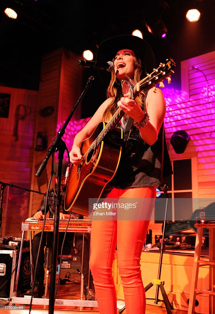 Singer/songwriter <a gi-track='captionPersonalityLinkClicked' href=/galleries/search?phrase=Kacey+Musgraves&family=editorial&specificpeople=4103138 ng-click='$event.stopPropagation()'>Kacey Musgraves</a> performs at Gilley's Saloon, Dance Hall & Bar-B-Que at the Treasure Island Hotel & Casino as she tours in support of the album 'Same Trailer Different Park' on July 29, 2013 in Las Vegas, Nevada.