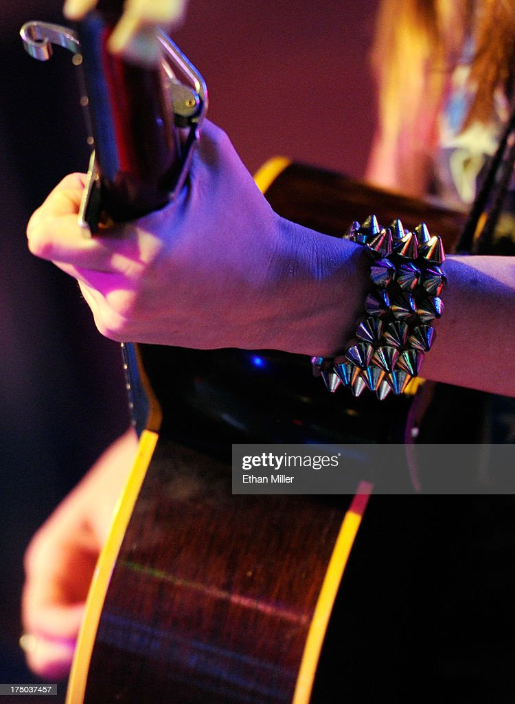 Singer/songwriter Kacey Musgraves (jewelry detail) performs at Gilley's Saloon, Dance Hall & Bar-B-Que at the Treasure Island Hotel & Casino as she tours in support of the album 'Same Trailer Different Park' on July 29, 2013 in Las Vegas, Nevada.