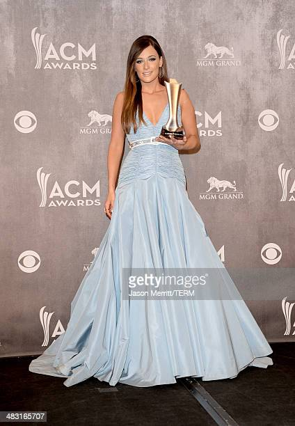 Singer/songwriter Kacey Musgraves poses in the press room with the Album of the Year award during the 49th Annual Academy of Country Music Awards at...