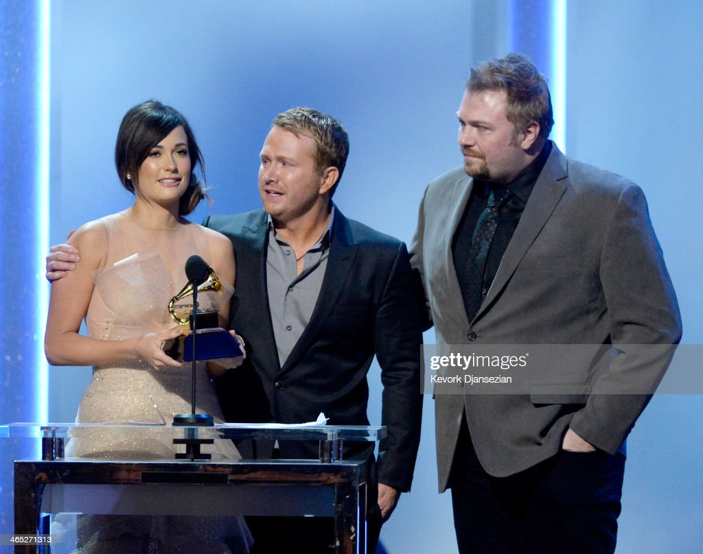 Singer/songwriter Kacey Musgraves, songwriters Shane McAnally and Josh Osborne accept the Best Country Song award for 'Merry Go 'Round' onstage during the 56th GRAMMY Awards Pre-Telecast Show at Nokia Theatre L.A. Live on January 26, 2014 in Los Angeles, California.