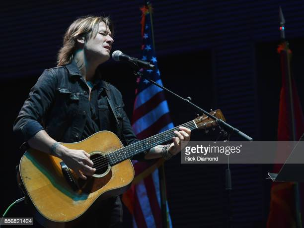 Singer/Songwriter Keith Urban performs 'Bridge Over Troubled Water' during Nashville Candelight Vigil For Las Vegas at Ascend Amphitheater on October...